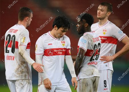 Stock Image of (L-R) Philipp Forster, Wataru Endo, Orel Mangala and Sasa Kalajdzic of VfB Stuttgart looks dejected following the DFB Cup Round of Sixteen match between VfB Stuttgart and Borussia Moenchengladbach at Mercedes-Benz Arena in Stuttgart, Germany, 03 February 2021.