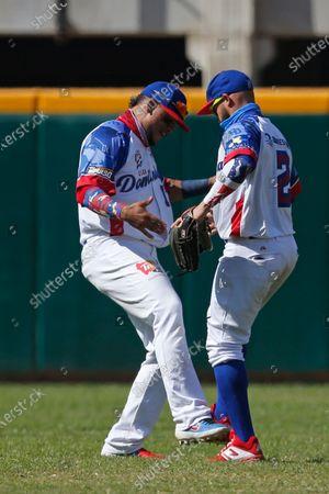 Dominican Republic's Juan Lagares, left, and Juan Carlos Perez, celebrate after defeating Venezuela 2-0 during a Caribbean Series baseball game at the Teodoro Mariscal stadium in Mazatlan, Mexico