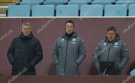 Aston Villa manager Dean Smith, left, with coaching staff John Terry, center, and Craig Shakespeare look on during the English Premier League soccer match between Aston Villa and West Ham United at Villa Park in Birmingham, England, Wednesday, Feb.3, 2021