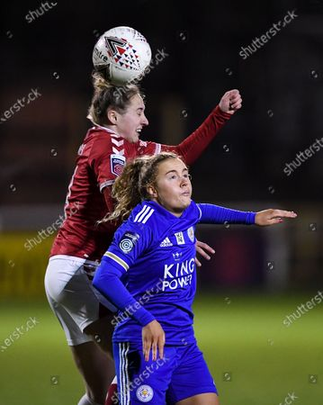 Aimee Palmer of Bristol City contends for the aerial ball with Charlie Devlin of Leicester City