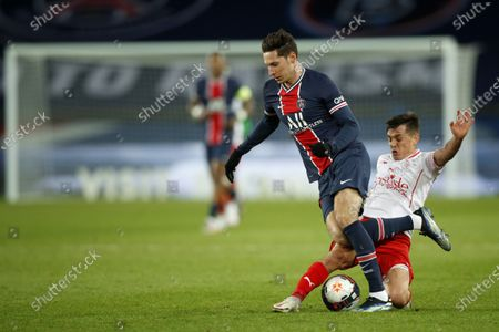 Paris Saint Germain's Julian Draxler (C) in action against Nimes Olympique's Andres Cubas (R) during the French soccer Ligue 1 match between PSG and Nimes Olympique at the Parc des Princes stadium in Paris, France, 03 February 2021.