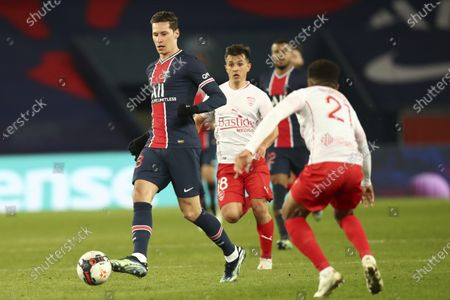 PSG's Julian Draxler passes the ball during the French League One soccer match between Paris Saint-Germain and Nimes at the Parc des Princes stadium in Paris, France