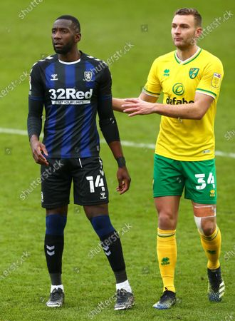New loan signing, Yannick Bolasie of Middlesbrough is marked by Ben Gibson of Norwich City