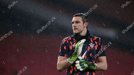 Southampton's goalkeeper Alex McCarthy during the warm up before the English Premier League soccer match between Manchester United and Southampton, at the Old Trafford stadium in Manchester, England