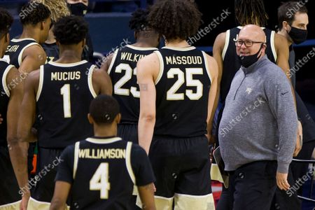Wake Forest head coach Steve Forbes looks at his players as they come off the court during a timeout during an NCAA college basketball game against Notre Dame, in South Bend, Ind. Notre Dame won 79-58