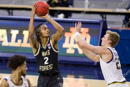 Wake Forest's Jalen Johnson (2) shoots over Notre Dame's Dane Goodwin (23) during an NCAA college basketball game, in South Bend, Ind. Notre Dame won 79-58