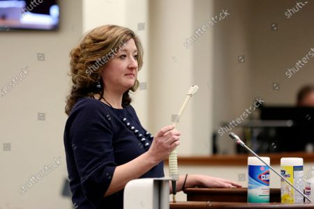 "Melissa Anne ""Mac"" Cunningham-Sereque shows the wand used to do ultrasound on pregnant women during a South Carolina House subcommittee hearing on an abortion bill, in Columbia, S.C. The bill would outlaw almost all abortions in the state"