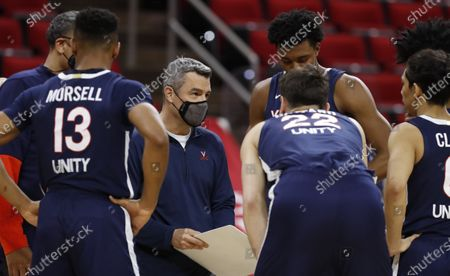 Stock Picture of Virginia head coach Tony Bennett talks to his team during the first half of an NCAA college basketball game, in Raleigh, N.C