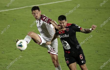 Daniel Colindres (L) of Saprissa in action against Jose Salvatierra (R) of Alajuelense during the final soccer match of the CONCACAF Champions League at the Alejandro Morera Soto Stadium in San Jose, Costa Rica, 03 February 2021.