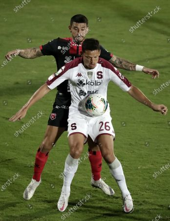Stock Image of Daniel Colindres (R) of Saprissa in action against Jose Salvatierra (L) of Alajuelense during the final soccer match of the CONCACAF Champions League at the Alejandro Morera Soto Stadium in San Jose, Costa Rica, 03 February 2021.