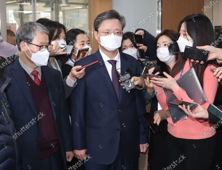 Woo Byung-woo (C), former presidential secretary for civil affairs for ousted president Park Geun-hye, speaks to reporters at the Seoul High Court after the court handed down a reduced sentence to Woo in a corruption scandal that led to Park's removal from office in 2017. Woo was sentenced to one year in prison after the court cleared him of multiple charges.