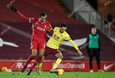 Liverpool's Joel Matip, left, controls the ball during the English Premier League soccer match between Liverpool and Burnley in Liverpool, England, .Burnley won the match 0-1