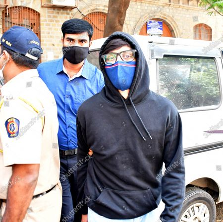 Bollywood actor Sushant Singh Rajput's former assistant director Rishikesh Pawar being taken for medical examination after his arrest in connection with Rajput's death, on February 3, 2021 in Mumbai, India. The Narcotics Control Bureau (NCB) on Tuesday arrested former assistant director Rishikesh Pawar in connection with the death of actor Sushant Singh Rajput. Pawar allegedly procured drugs and supplied it to Sushant Singh Rajput for monetary benefit. One of Sushant's staff members, Dipesh Sawant, named Pawar as one of the persons supplying drugs to the actor.