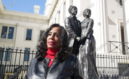 Lynne Jackson, the great, great grand daughter of Dred and Harriett Scott stands outside of the Old Courthouse near a statue of the Scotts at the Old Courthouse in St. Louis on Wednesday, February 3, 2021. The Old Courthouse at Gateway Arch National Park is where Dred and Harriet Scott sued for freedom, beginning in 1846, and will undergo renovations beginning in late 2021, with construction lasting approximately two years.