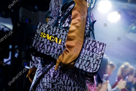 Model on the catwalk, bag detail, at the Sacai Fashion show in Paris, Fall Winter 2020, Ready to Wear Fashion WeekCollection designed by Chitose Abe