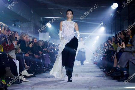 Model on the catwalk at the Sacai Fashion show in Paris, Fall Winter 2020, Ready to Wear Fashion WeekCollection designed by Chitose Abe