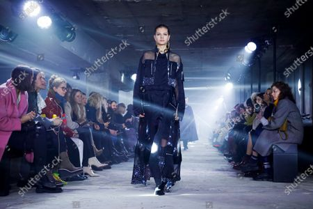 Stock Photo of Model on the catwalk at the Sacai Fashion show in Paris, Fall Winter 2020, Ready to Wear Fashion WeekCollection designed by Chitose Abe