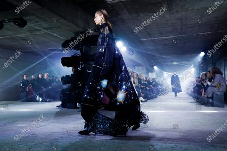 Stock Picture of Model on the catwalk at the Sacai Fashion show in Paris, Fall Winter 2020, Ready to Wear Fashion WeekCollection designed by Chitose Abe