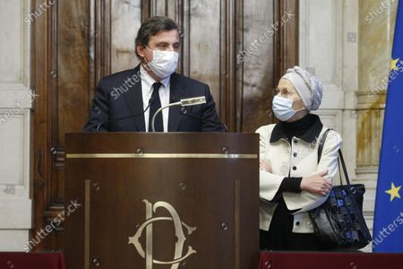 Carlo Calenda (L), member of 'Azione' and Emma Bonino (R), member of '+ Europa' during a press conference after meeting with designated-prime minister Mario Draghi, for the formation of a new government in Rome, Italy, 04 February 2021. Draghi accepted on 03 February a mandate from the Italian president to form a national unity government after the previous coalition collapsed.
