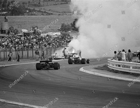 Cars stream past the fiery accident involving Mike Hailwood, Clay Regazzoni and Jacky Ickx on lap 3South African GP, Kyalami, 3 March 1973