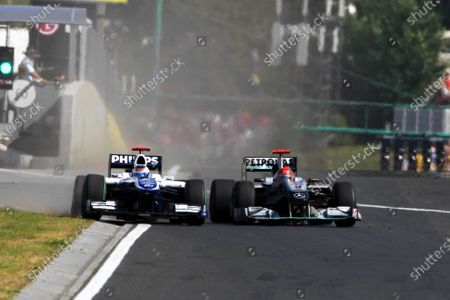 Michael Schumacher (GER) Mercedes GP MGP W01 squeezes Rubens Barrichello (BRA) Williams FW32 into the pit wall and onto the grass.Formula One World Championship, Rd 12, Hungarian Grand Prix, Race, Budapest, Hungary, Sunday 1 August 2010. BEST IMAGE