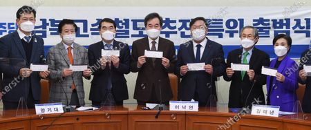 Officials of the ruling Democratic Party (DP), including leader Lee Nak-yon (C), pose for a photo during a ceremony to launch a special committee to push for an inter-Korean high-speed railway project at the party headquarters in Seoul, South Korea, 04 February 2021.