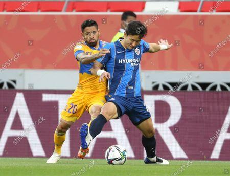 Javier Aquino of Tigres UANL, left, and Ulsan Hyundai's Bae Jaewoo fight for the ball during FIFA Club World Cup in Al Rayyan, Qatar