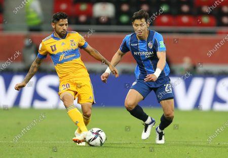 Javier Aquino of Tigres UANL passes the ball in front of Ulsan Hyundai's Kim Taehwan during FIFA Club World Cup in Al Rayyan, Qatar