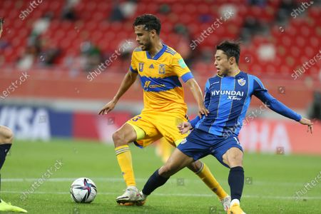 Diego Reyes of Tigres UANL, left, and Ulsan Hyundai's Lee Dongjun fight for the ball during FIFA Club World Cup in Al Rayyan, Qatar