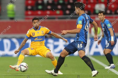 Javier Aquino (L) of Tigres in action against Kim Keehee of Ulsan during the 2nd round match between Tigres UANL and Ulsan Hyundai FC at the FIFA Club World Cup in Al Rayyan, Qatar, 04 February 2021.
