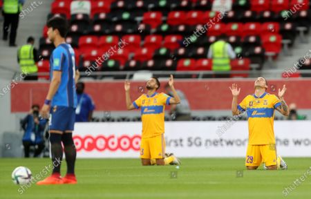 Tigres players Diego Reyes and Jesus Duenas (R) before the kick-off of the 2nd round match between Tigres UANL and Ulsan Hyundai FC at the FIFA Club World Cup in Al Rayyan, Qatar, 04 February 2021.