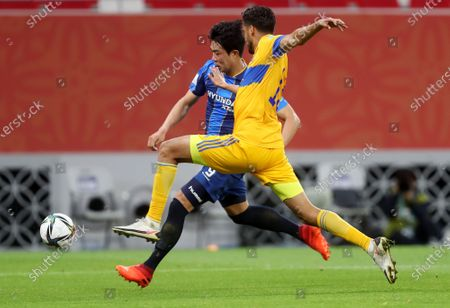 Diego Reyes (R) of Tigres in action against Kim Jihyun of Ulsan during the 2nd round match between Tigres UANL and Ulsan Hyundai FC at the FIFA Club World Cup in Al Rayyan, Qatar, 04 February 2021.