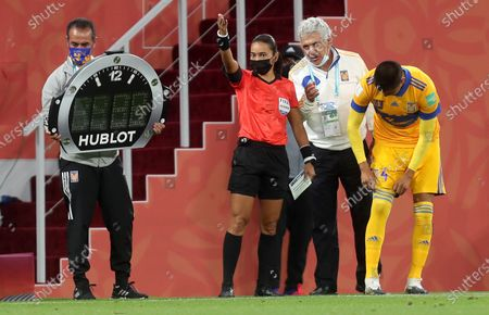 Stock Picture of Fourth official Edina Alves Batista (C) of Brazil gestures on the touchline next to Tigres head coach Ricardo Ferretti (2-R) and Tigres player Hugo Ayala (R) during the 2nd round match between Tigres UANL and Ulsan Hyundai FC at the FIFA Club World Cup in Al Rayyan, Qatar, 04 February 2021.