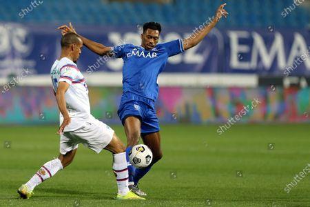 Stock Image of Al-Hilal's player Mohamed Kanno (R) in action against Abha's Abdulrahman Al-Barakah (L) during the Saudi Professional League soccer match between Al-Hilal and Abha at Prince Faisal Bin Fahd Stadium, in Riyadh, Saudi Arabia, 04 February 2021.