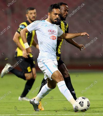 Al-Ittihad's player Fahad Al Muwallad (R) in action against Al-Fateh's Ali Al-Zaqan (L) during the Saudi Professional League soccer match between Al-Ittihad and Al-Fateh at King Abdulaziz Stadium, in Mecca, Saudi Arabia, 04 February 2021.