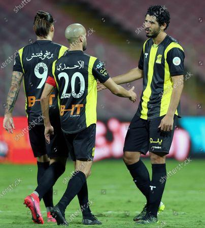 Al-Ittihad's player Aleksandar Prijovic (L) celebrates with teammates after scoring a goal during the Saudi Professional League soccer match between Al-Ittihad and Al-Fateh at King Abdulaziz Stadium, in Mecca, Saudi Arabia, 04 February 2021.