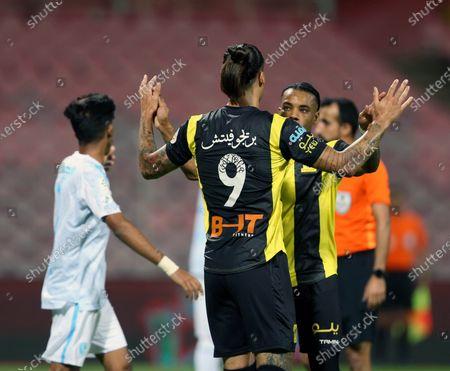 Al-Ittihad's player Aleksandar Prijovic (2-L) celebrates with teammates after scoring a goal during the Saudi Professional League soccer match between Al-Ittihad and Al-Fateh at King Abdulaziz Stadium, in Mecca, Saudi Arabia, 04 February 2021.