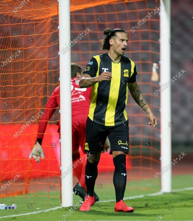 Al-Ittihad's player Aleksandar Prijovic (R) scores a goal against Al-Fateh's goalkeeper Maksym Koval (L) during the Saudi Professional League soccer match between Al-Ittihad and Al-Fateh at King Abdulaziz Stadium, in Mecca, Saudi Arabia, 04 February 2021.