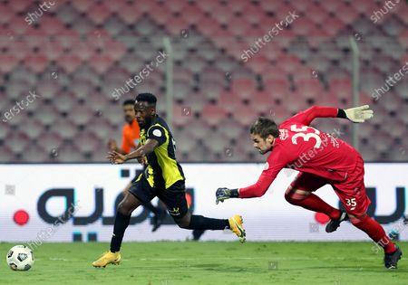 Al-Ittihad's player Fahad Al Muwallad (L) in action against Al-Fateh's goalkeeper Maksym Koval (R) during the Saudi Professional League soccer match between Al-Ittihad and Al-Fateh at King Abdulaziz Stadium, in Mecca, Saudi Arabia, 04 February 2021.