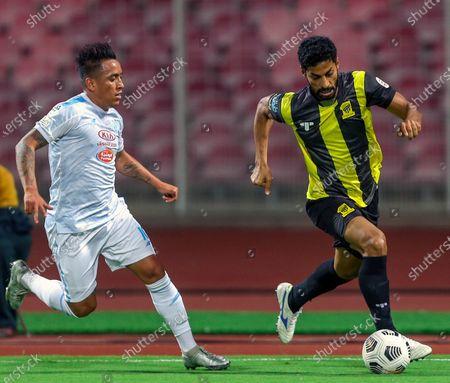 Al-Ittihad's player Abdulaziz Al Jebreen (R) in action against Al-Fateh's Christian Cueva (L) during the Saudi Professional League soccer match between Al-Ittihad and Al-Fateh at King Abdulaziz Stadium, in Mecca, Saudi Arabia, 04 February 2021.