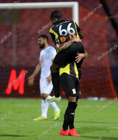 Al-Ittihad's player Aleksandar Prijovic (back) celebrates with a teammate after scoring a goal during the Saudi Professional League soccer match between Al-Ittihad and Al-Fateh at King Abdulaziz Stadium, in Mecca, Saudi Arabia, 04 February 2021.