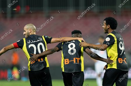 Al-Ittihad's player Fahad Al Muwallad (C) celebrates with teammates after scoring a goal during the Saudi Professional League soccer match between Al-Ittihad and Al-Fateh at King Abdulaziz Stadium, in Mecca, Saudi Arabia, 04 February 2021.