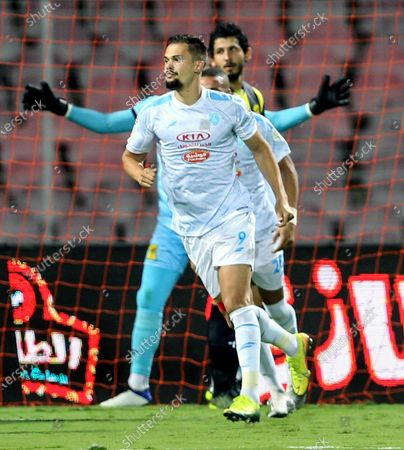 Al-Fateh's player Mitchell Te Vrede (front) celebrates after scoring a goal during the Saudi Professional League soccer match between Al-Ittihad and Al-Fateh at King Abdulaziz Stadium, in Mecca, Saudi Arabia, 04 February 2021.