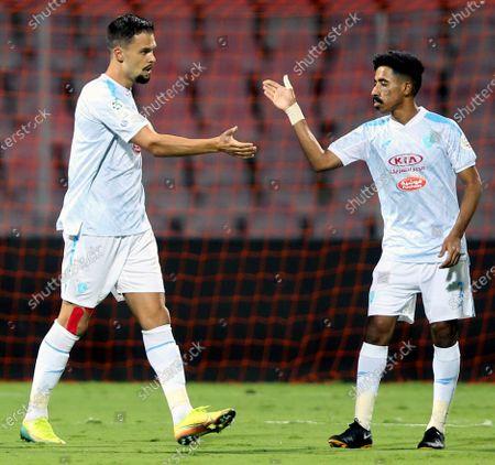 Al-Fateh's player Mitchell Te Vrede (L) celebrates with a teammate after scoring a goal during the Saudi Professional League soccer match between Al-Ittihad and Al-Fateh at King Abdulaziz Stadium, in Mecca, Saudi Arabia, 04 February 2021.