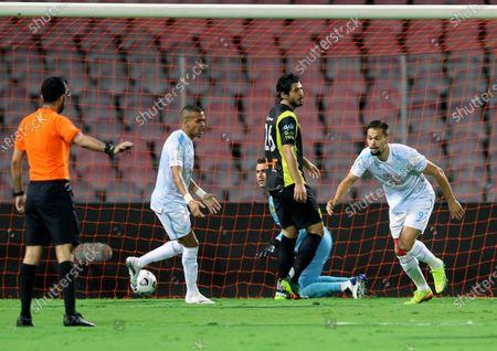 Al-Fateh's player Mitchell Te Vrede (R) celebrates after scoring a goal during the Saudi Professional League soccer match between Al-Ittihad and Al-Fateh at King Abdulaziz Stadium, in Mecca, Saudi Arabia, 04 February 2021.