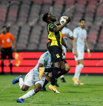 Al-Ittihad's player Fahad Al Muwallad (front) in action during the Saudi Professional League soccer match between Al-Ittihad and Al-Fateh at King Abdulaziz Stadium, in Mecca, Saudi Arabia, 04 February 2021.