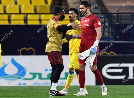 Al-Nassr's goalkeeper Brad Jones (R) celebrates after winning the Saudi Professional League soccer match between Al-Nassr and Al-Taawoun at King Saud University Stadium, in Riyadh, Saudi Arabia, 04 February 2021.