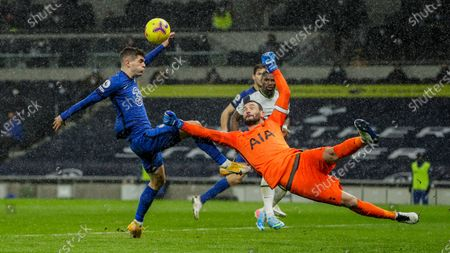 Chelsea's Christian Pulisic tries to score and Tottenham's goalkeeper Hugo Lloris, right, clears the ball during the English Premier League soccer match between Tottenham and Chelsea at the Tottenham Hotspur Stadium in London, England
