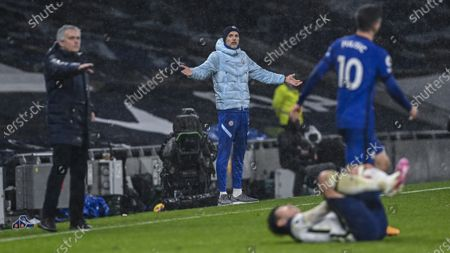 Chelsea's head coach Frank Lampard, background, reacts during the English Premier League soccer match between Tottenham and Chelsea at the Tottenham Hotspur Stadium in London, England