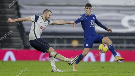 Chelsea's Christian Pulisic, right, and Tottenham's Eric Dier duel for the ball during the English Premier League soccer match between Tottenham and Chelsea at the Tottenham Hotspur Stadium in London, England